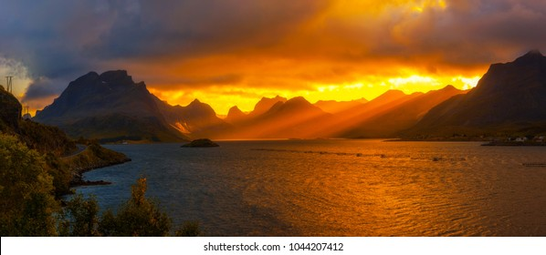 Dramatic sunset over the mountains and the sea of Lofoten islands in Norway