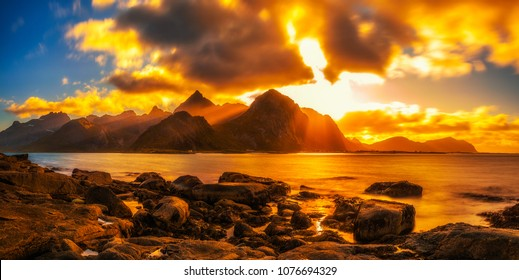 Dramatic sunset over the mountains and the sea of Lofoten islands in Norway. Long exposure.