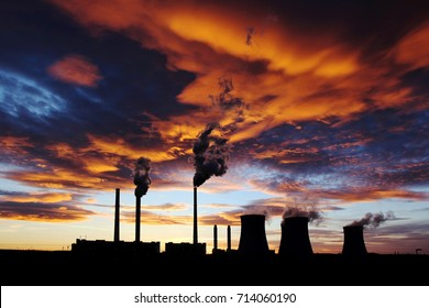 dramatic sunset over power plant