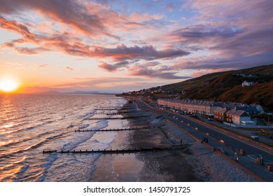 Dramatic sunset over scenic coastal town Barmouth in North Wales, UK