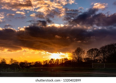 dramatic sunset over soccer field