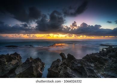 Dramatic sunset in Pantai Pero, Sumba Island in Indonesia.