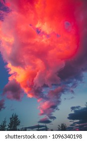Dramatic sunset Pink sky background with clouds Beautiful nature at twilight time. Magnificent views on moody pink, purple and blue cloudy sun set sky shot vertical