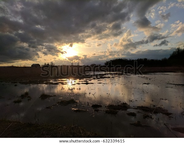 Dramatic sunset in a puddle