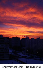Dramatic sunset, red clouds on the city