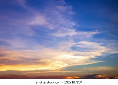 Dramatic sunset sky with beautiful cirrus clouds.