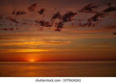 Dramatic sunset sky with clouds. Dramatic sunset over the sea - Shutterstock ID 1979624261