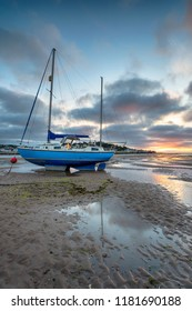 Dramatic sunset sky over a sailing boat at Instow near Bideford on the north coast of Devon