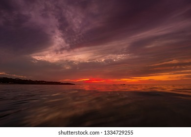 Dramatic sunset sky over water, long exposure