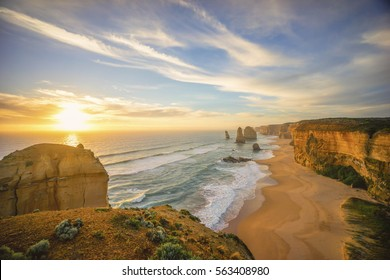 Dramatic sunset sky at unique rock formation along a coastline. The Twelve Apostles, Great Ocean Road, Victoria Australia