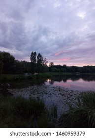 Dramatic sunset sky and water lily pond during summer evening