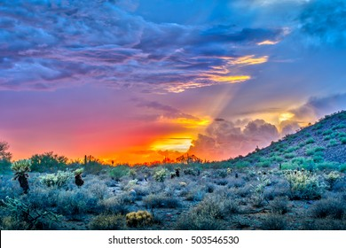Dramatic sunset in the Sonoran desert in Scottsdale, Arizona. Dramatic cloudscape captured with 5 image HDR photo.
