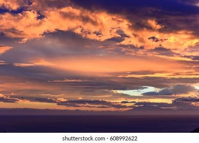 dramatic Sunset sunrise orange clouds horizontal photo
