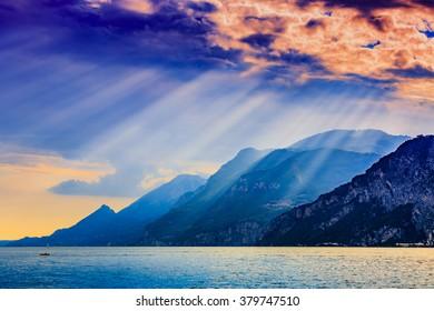 Dramatic sunset view of Garda Lake in Italy.