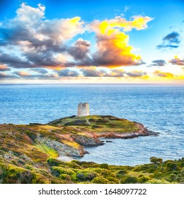 Dramatic sunset view of Piscinni bay with turquoise sea and famous coastal tower of Piscinni.  Beautiful Mediterranean seascape.  Location:  Teulada, Sardinia, Italy Europe