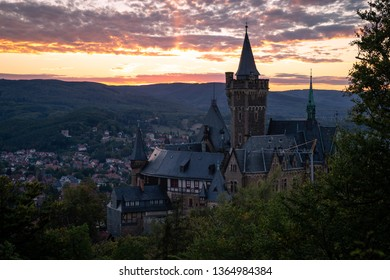 Dramatic sunset in Wernigerode with the structural landmark of the castle