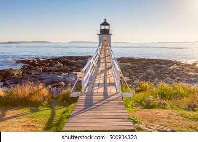 Dramatic sunsets  at the Marshall Point lighthouse, located in Port Clyde,  in Maine