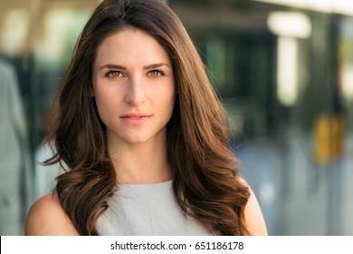 Dramatic theatrical headshot of serious woman intense eyes powerful glare, beautiful confidence