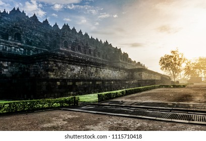Dramatic view of ancient stupa borobudur temple with ray sunrise in the morning. the world's largest Buddhist temple and UNESCO World Heritage Site. Magelang, Yogyakarta,Central Java, Indonesia