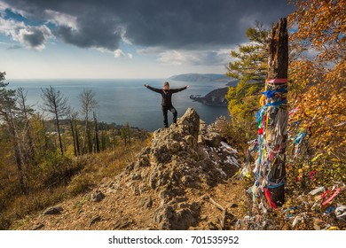 Dramatic view to Baikal Lake with posing woman, autumn time in Russia