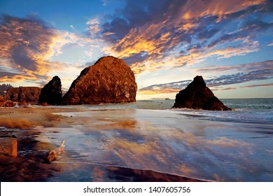 dramatic view of beach in brookings in oregon at sunset