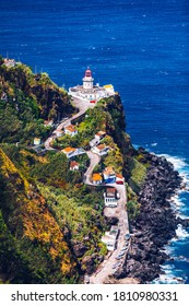 Dramatic view down to lighthouse on Ponta do Arnel, Nordeste, Sao Miguel Island, Azores, Portugal. Lighthouse Arnel near Nordeste on Sao Miguel Island, Azores, Portugal.
