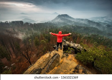 Dramatic view into landscape of Bohemian Switzerland National Park with standing man, Czech Republic, Europe