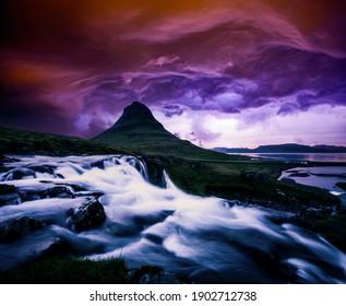 Dramatic view of Kirkjufellsfoss waterfall at sunset. Location place Kirkjufell volcano, Iceland, Europe. Image of most popular world landmarks. Vibrant photo wallpaper. Discover the world of beauty.