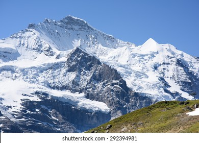 Dramatic view of the north side of the Jungfrau in the Bernese Oberland, Switzerland, showing glaciers. The railway journey up to the Jungfraujoch is a highlight of any vacation in the Swiss Alps.