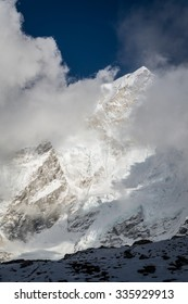Dramatic view of Nuptse peak showing through the clouds. The photo was taken in Gorak Shep, the last village on the way to Everest Base Camp, Nepal