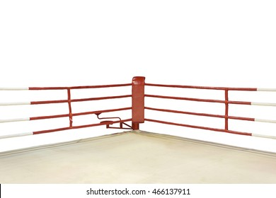 A dramatic view of the red corner of a regular boxing ring surrounded by ropes spotlit by a spotlight on an isolated white background. This has clipping path.
