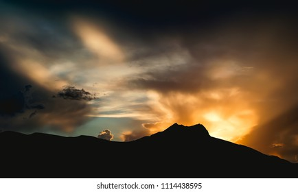 Dramatic view of sunset in hills from the top of the mountain