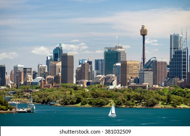 Dramatic view at Sydney city urban skyline from Western Plains with blue sky and clouds on a bright day