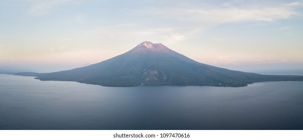 The dramatic volcano of Ile Ape rises on the island of Lembata in Indonesia. This remote, tropical region, within the Coral Triangle, harbors extraordinary marine biodiversity.