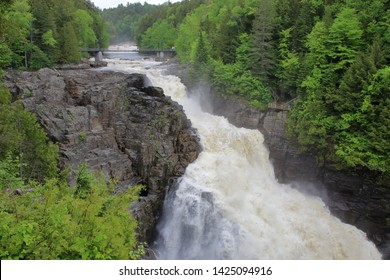 Dramatic waterfall, or chutes, of the Sainte Anne du Nord River located in Sainte Anne Canyon gorge, in Quebec, Canada