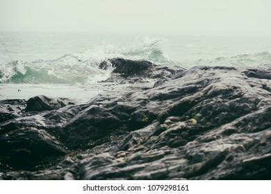 Dramatic waves on a rocky coastline.