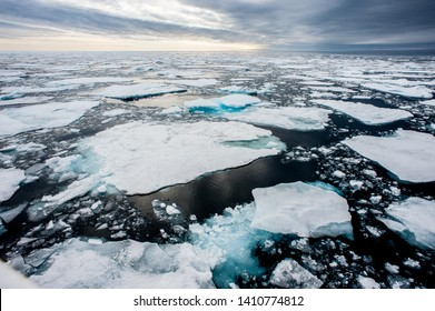Dramatic wide angle view of arctic ice floes breaking up taken at sea.climate crisis - Image