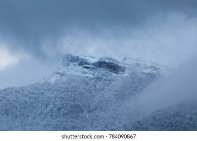 Dramatic winter mountain scenery at Slovakia, Mala Fatra, Klak. Snow storm closing in on frozen forests and hiding Klak peak to cold winter mist.