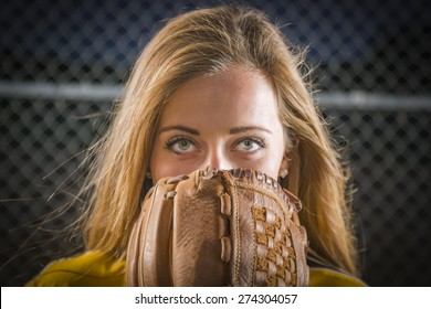 Dramatic Young Woman with Softball Glove Covering Her Face Outdoors.