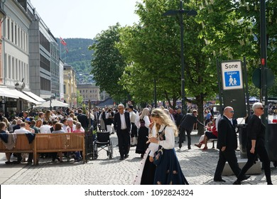 Drammen, Buskerud, Norway - May 17, 2018 : People walking on streets on Norway's National Day 17th of May. Many of norwegian wear on this day traditional clothes.