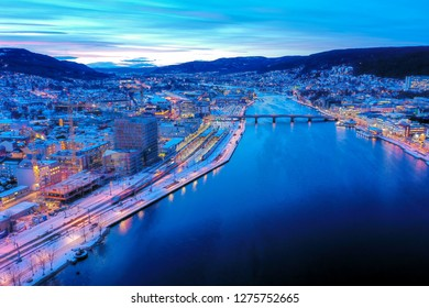 Drammen city, Norway - January 4, 2019: Aerial image which show a part of Drammen city. This image was taken with a drone just before sunset.