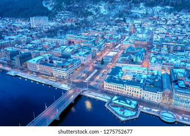 Drammen city, Norway - January 4, 2019: Aerial image which show downtown of Drammen city. This image was taken with a drone just before sunset.