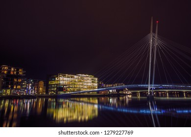 Drammen city, Norway. The river is called Drammenselva, and the cable-stayed bridge over the river is called Ypsilon. The area around the river is popular among the tourist.
