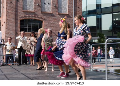 Drammen, Norway - 25. August, 2018: Drammen Elvefestival, Union Brygge. Vintage dress show with music and dance.