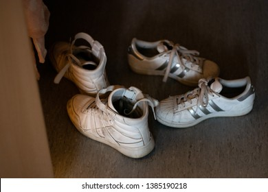 Drammen, Norway - April 30th 2019: White shoes, sneakers, in the hall.