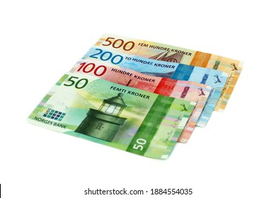Drammen, Norway - December 29 2020: Norwegian currency notes of 50 kroner, 100 kroner, 200 kroner and 500 kroner denominations by Norges Bank on isolated white background.