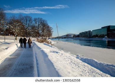Drammen, Norway - February 3, 2019: Winter in Drammen. This image show the area around thr river Drammenselva. This is a popular place in Drammen downtown. Many use this area for hiking.