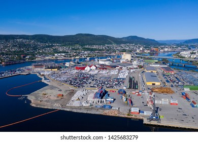 Drammen, Norway - June 15. 2019: The harbor in Drammen city. Car distribution centre, new cars parked in rows and ready for sale.