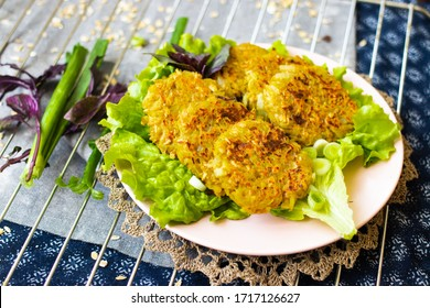 Draniki - traditional potato, onion baked or fried pancakes with lettuce salad leaves. Vegan food.