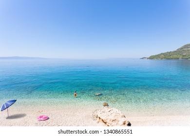 Drasnice, Dalmatia, Croatia, Europe - Relaxing at the beautiful beach of Drasnice
